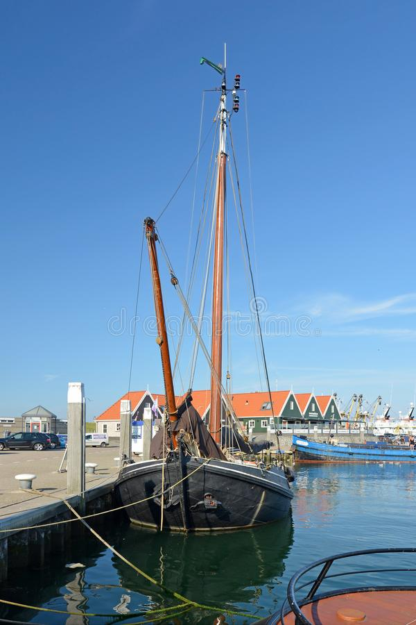Old sailing boat anchored at dock at Oudeschild harbor on island Texel royalty free stock photography