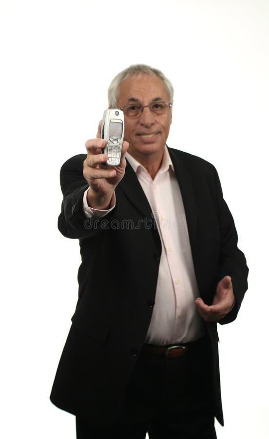 Oudste met cellphone stock foto