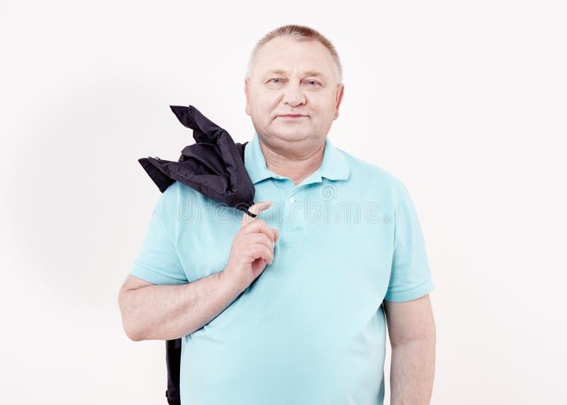 Oudste met jasje over schouder stock afbeelding
