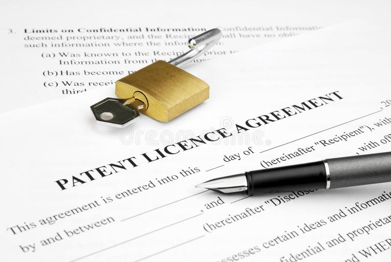 överenskommelselicencepatent arkivfoton