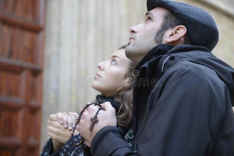 Oung Couple Praying To God Using Prayer Beads Royalty Free Stock Photo