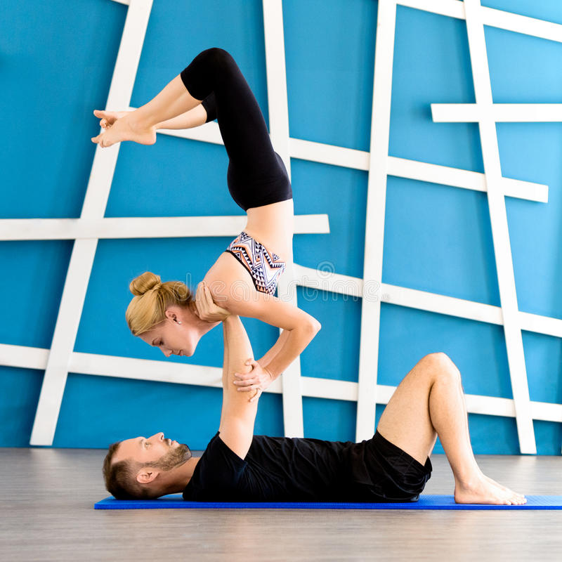 oung people in yoga class in Scorpion Pose. Yoga group concept stock photography