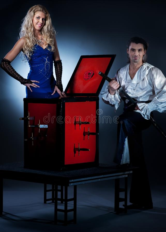 Download Ouple Performing Sword Box Illusion Stock Photo - Image: 12351132