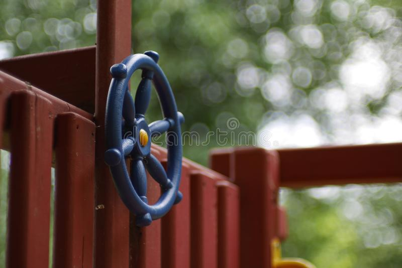 Blue Steering Wheel on Child`s Play Fort royalty free stock photo