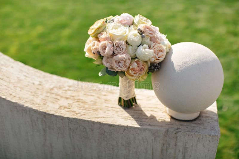 Our beautiful wedding. Beautiful bridal bouquet of peonies and roses stock photo