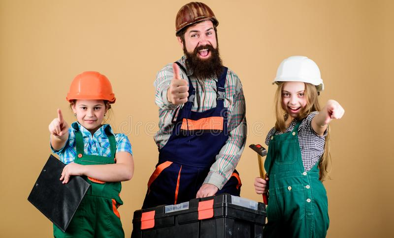 Our dad has skillful fingers. Sisters help father builder. Home renovation. Create room you really want live. Follow royalty free stock photos