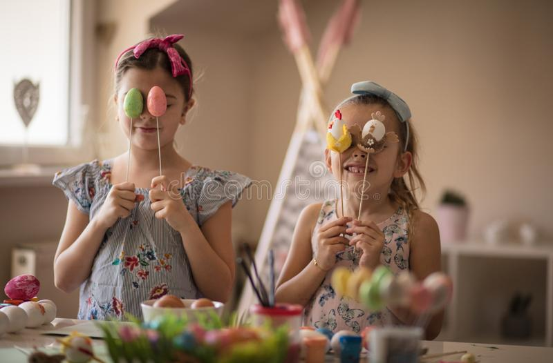 These are our Easter eggs. Little girls coloring Easter egg stock photo