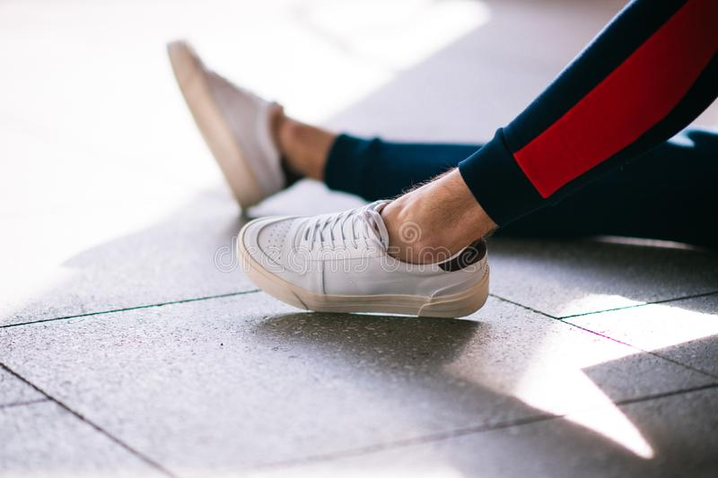 White Sneakers and Shoes in the Sun stock photos