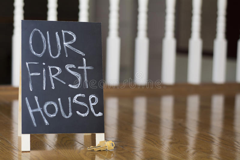 Our first house sign with keys stock image