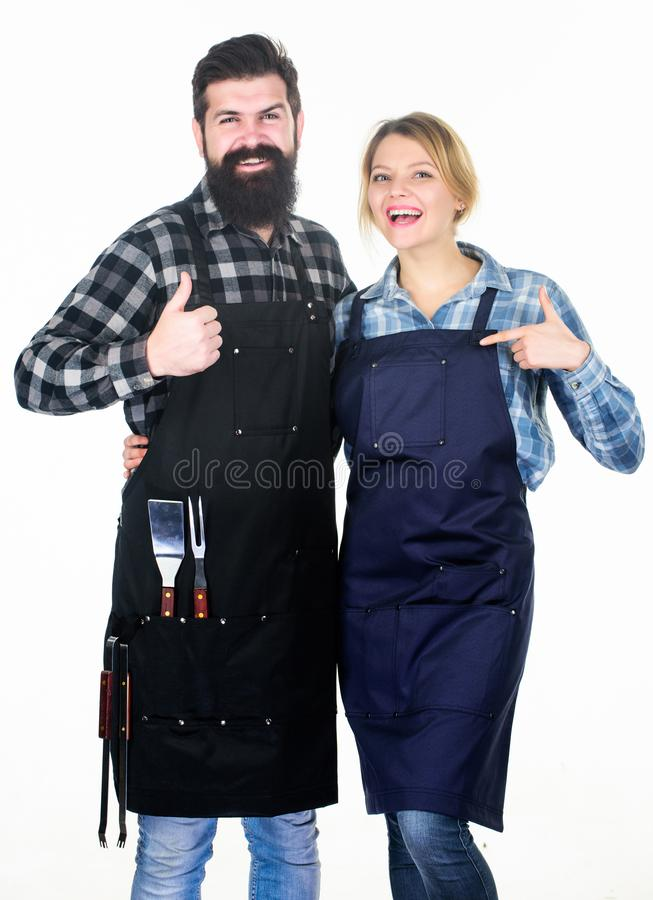 Our food. Tools for roasting meat. Couple in love hold kitchen utensils. Picnic barbecue. food cooking recipe. Family stock photography