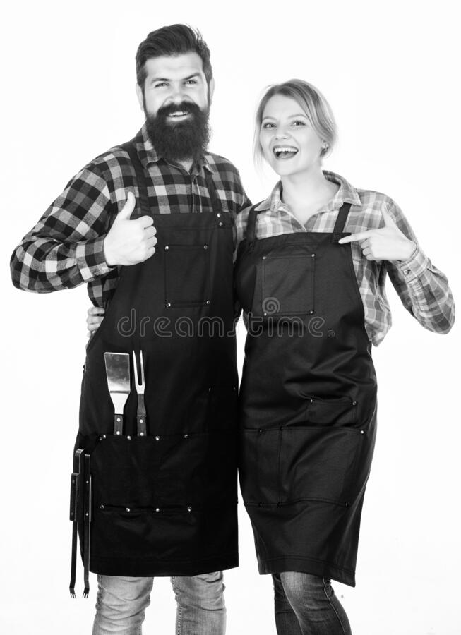 Our food. Tools for roasting meat. Couple in love hold kitchen utensils. Picnic barbecue. food cooking recipe. Family royalty free stock image