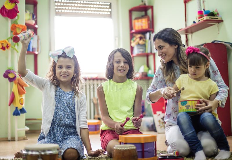 Our funny day with music. Children in preschool royalty free stock images