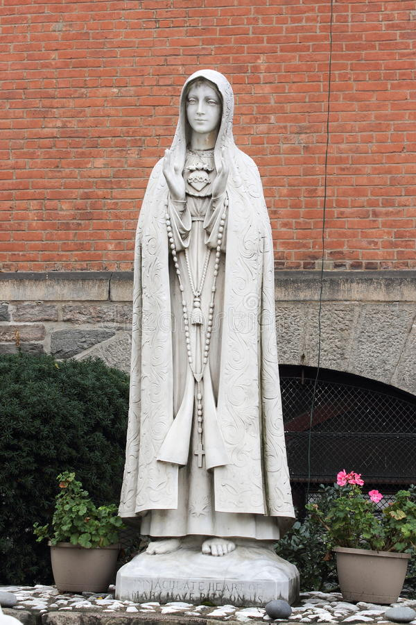 Our Lady of Fatima - Shrine Church of St. Anthony of Padua, New York. New York, USA - September 27, 2016: A Statue of Mary outside the Church of St. Anthony of royalty free stock photo