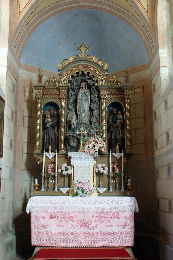 Our Lady of Lourdes altar in Church of Saint Roch in Kratecko, Croatia. Our Lady of Lourdes altar in Parish Church of Saint Roch in Kratecko, Croatia stock photography