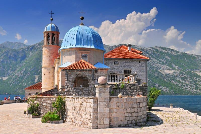 Our Lady of the Rock island and Church in Perast on shore of Boka Kotor bay Boka Kotorska Montenegro Europe stock photo