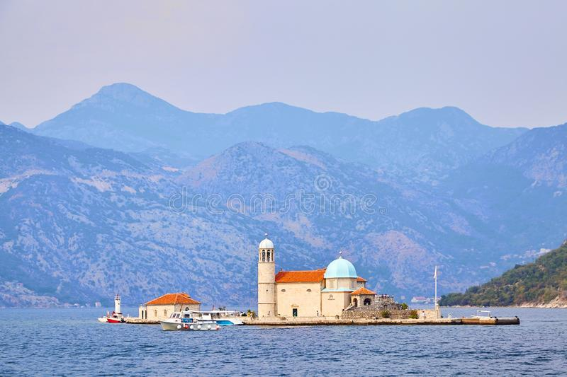 Our Lady of the Rocks church on island in Boka Kotor bay near Perast town and mountains, Adriatic Sea, Montenegro stock photos