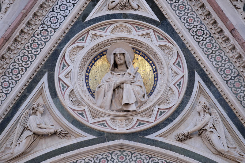Our Lady of Sorrows supported by Angels bearing Flowers, Portal of Florence Cathedral stock photos
