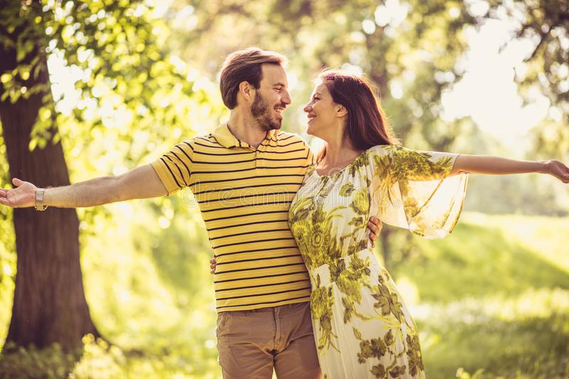 Our love is biggest on Earth. Happy middle age couple. Beauty in nature stock image