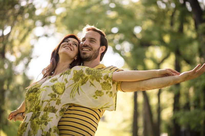 Our love is biggest on Earth. Happy middle age couple. Beauty in nature stock photography