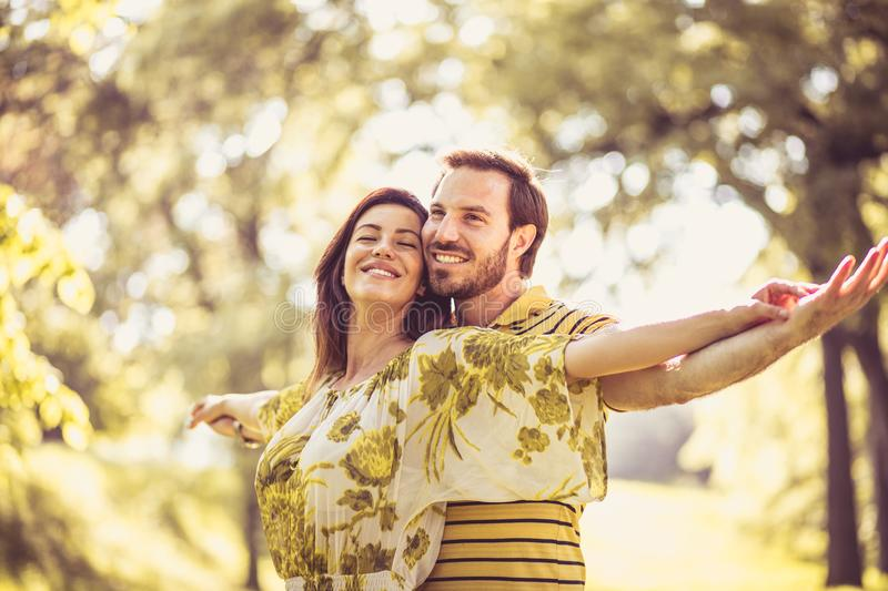 Our love is biggest on Earth. Happy middle age couple. Beauty in nature stock photos
