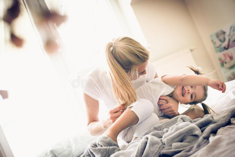 Our morning play in bed. royalty free stock image
