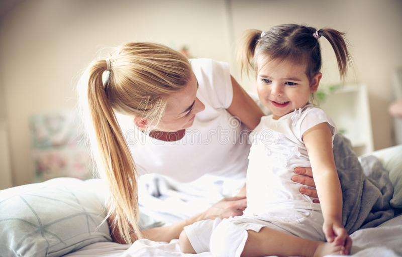 Our morning routine. Young mother with her child. Lifestyle royalty free stock photos