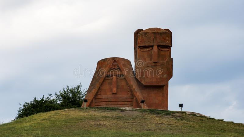 `we are our mountains` monument in stepanakert, artsakh, armenia. `We Are Our Mountains` is a large monument north of Stepanakert, the capital city of the de stock photos