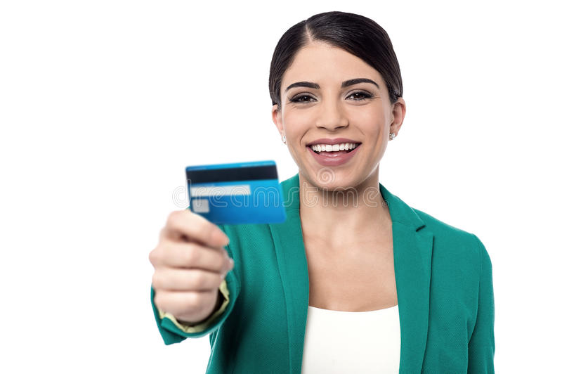 Our new gold credit card. Female executive showing a cash card to camera stock image