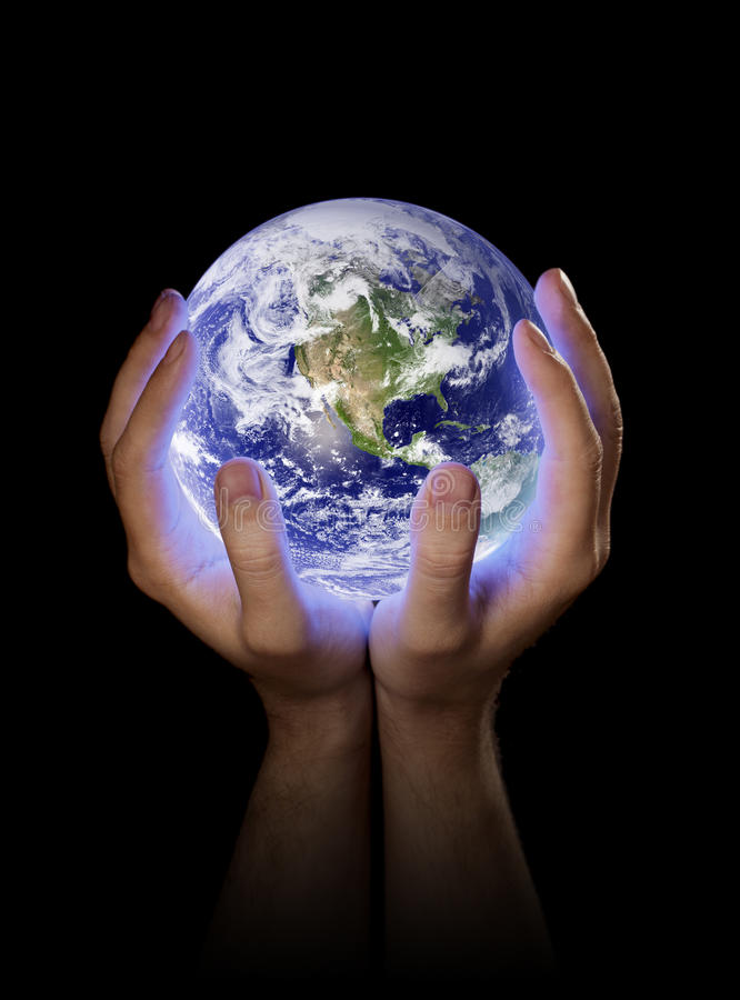 Our Planet Earth. Man holding a glowing planet earth in his hands. Earth image provided by NASA royalty free stock photo
