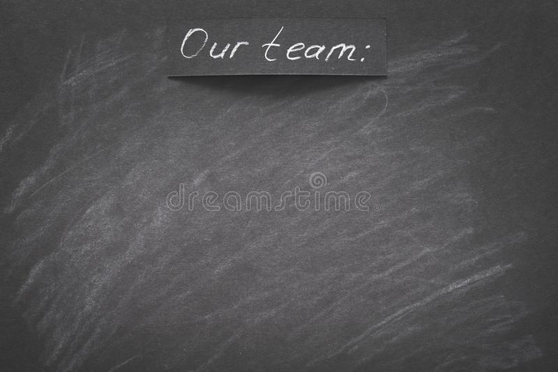 Our team written black chalkboard empty space royalty free stock photo