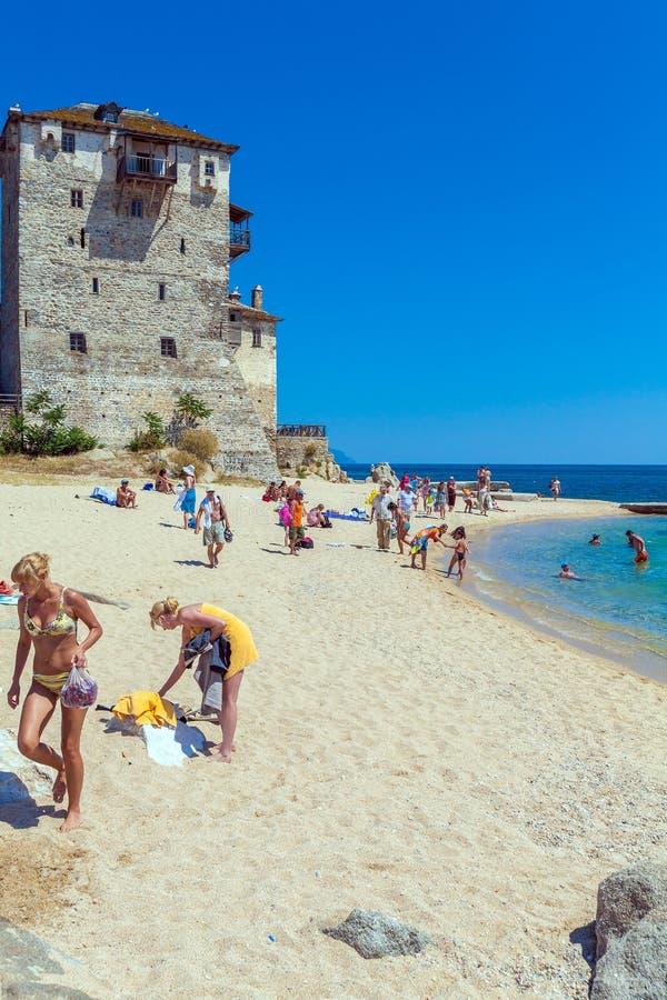 OURANOPOLIS, GREECE - JUNE 05, 2009: Tourists taking sun bath ne royalty free stock images