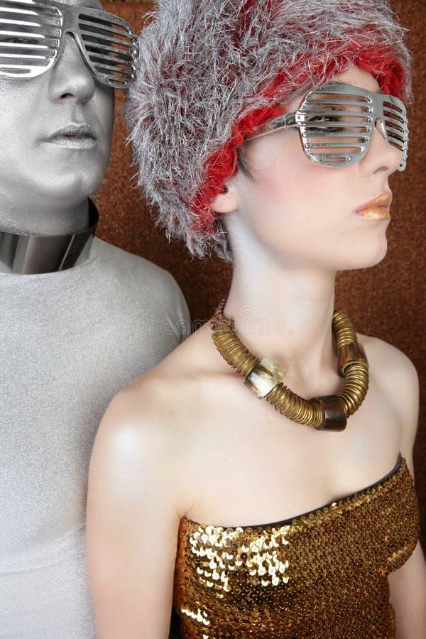 Ouro futurista estrangeiro da prata do retrato dos pares foto de stock