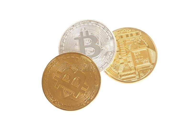 Ouro, prata e bronze de três moedas do bitcoin imagem de stock