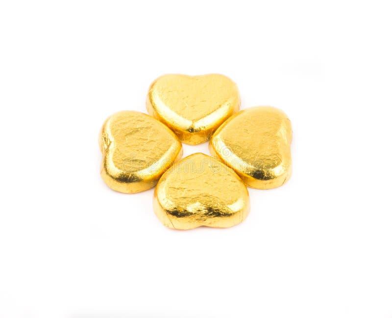 Ouro quatro chocolates do coração imagens de stock royalty free