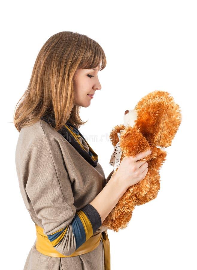 Ours de jouet de femme image stock