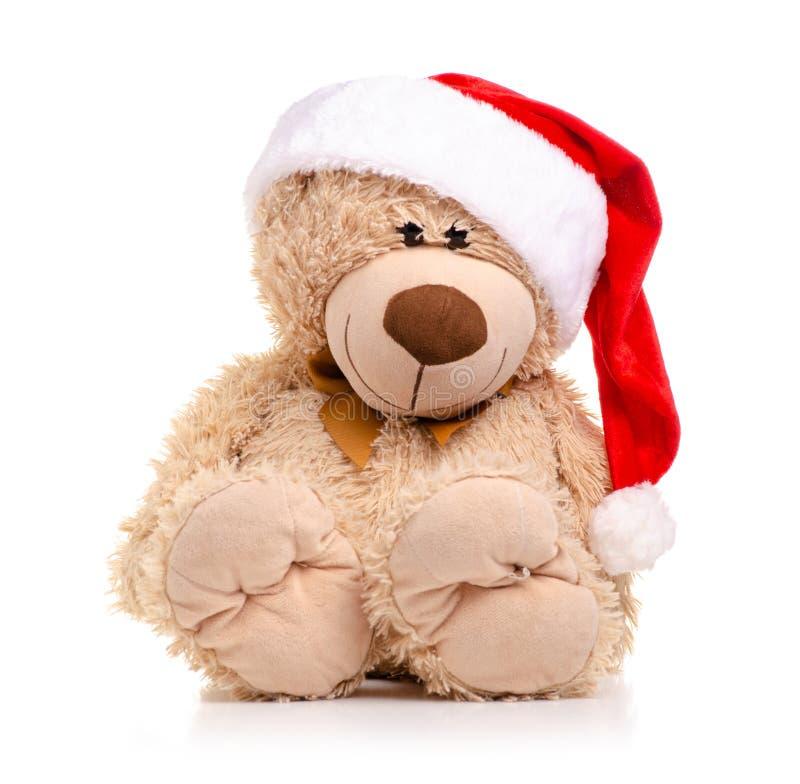 Ours de jouet de Noël avec le chapeau de Santa photos libres de droits