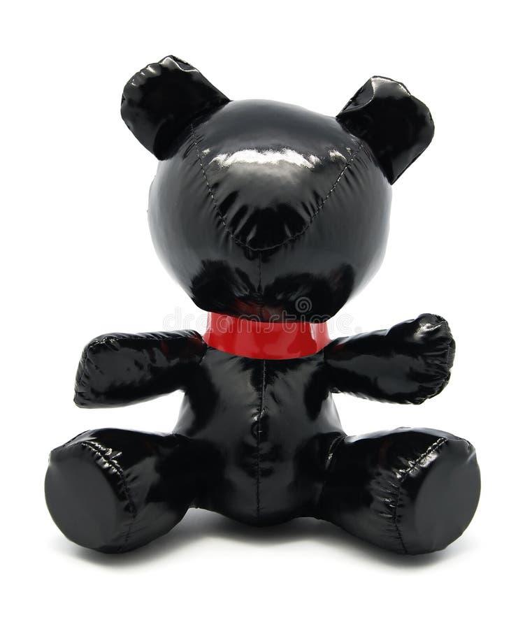 Ours noir de jouet de latex d'isolement sur le fond blanc photos libres de droits