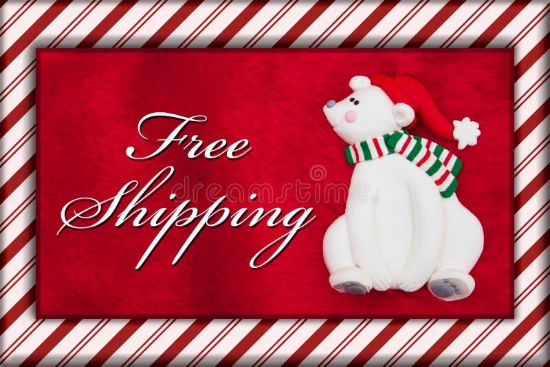Ours rouge de fourrure et de Noël de peluche avec le message gratuit d'expédition images stock