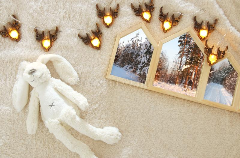 ouses shape wooden photo frames over cozy and warm fur carpet. Scandinavian style design. Top view. royalty free stock images