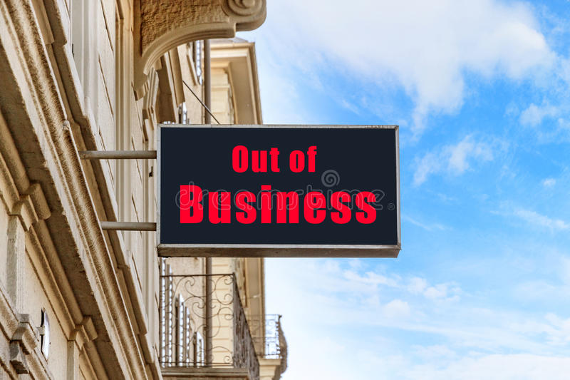 Out of Business. Sign, red letters on black background, blue sky stock images
