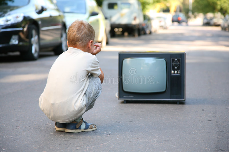 Out of connection. Child watch old tv on street