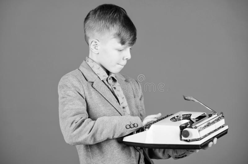 Out of date. I need modern gadget instead this retro. Outdated gadget. Retro and vintage. Yard sale. Retrospective study. Boy hold retro typewriter on blue royalty free stock image