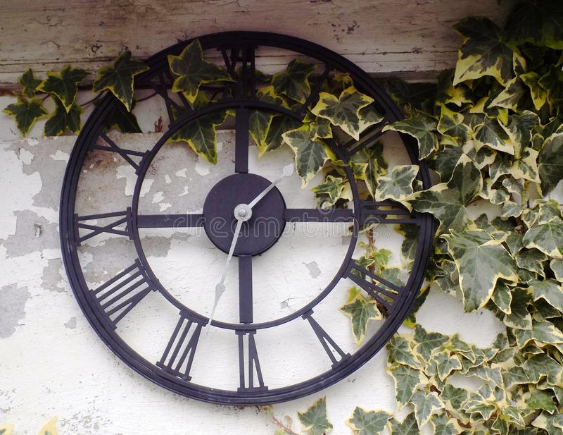 Out door garden clock royalty free stock photo