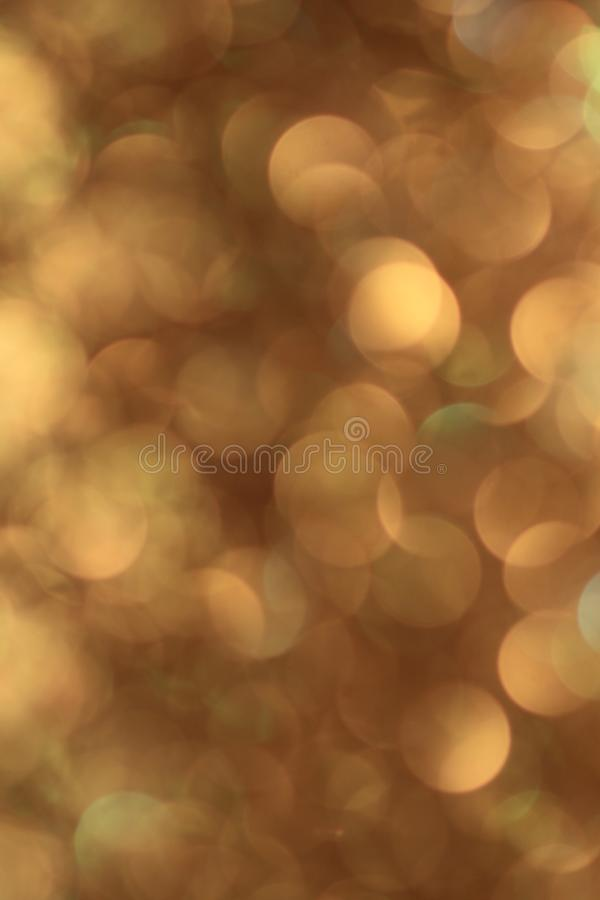 Out of focus golden circles royalty free stock photography