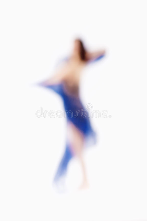 Out of Focus Image of a Woman with Blue Cloth. Abstract Out of Focus Image of a Woman with Blue Cloth royalty free stock images