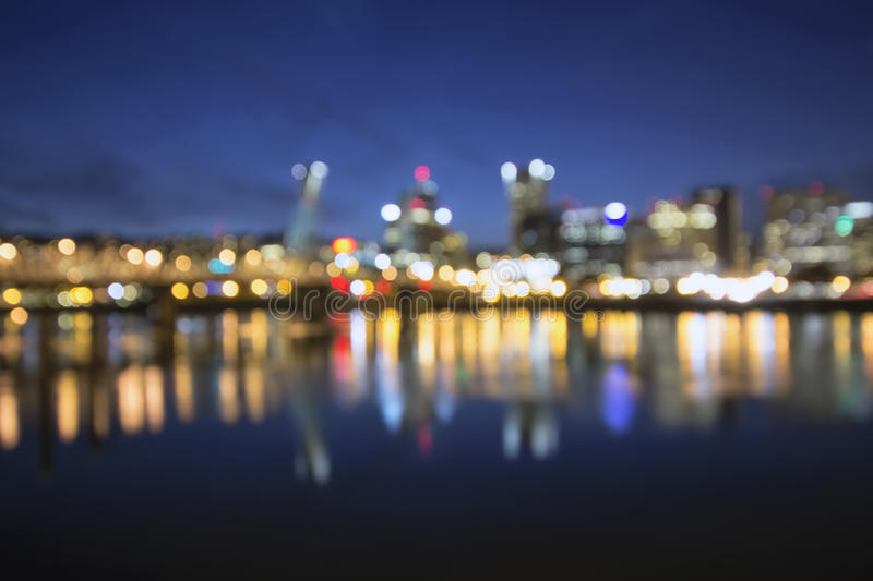 Out of Focus Portland City Skyline at Blue Hour. Out of Focus Portland Oregon Skyline with Hawthorne Bridge and Willamette River City Lights Reflection at Blue royalty free stock photo