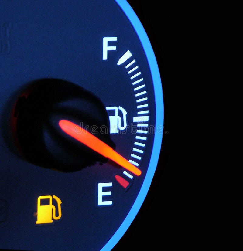 Out Of Gas. A closeup of a car's gas gauge - portrays the concept of running on fumes or empty