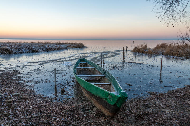 Out from ice captivity. The wooden boat was managed to be pulled out from ice captivity, otherwise it would be crushed royalty free stock photo