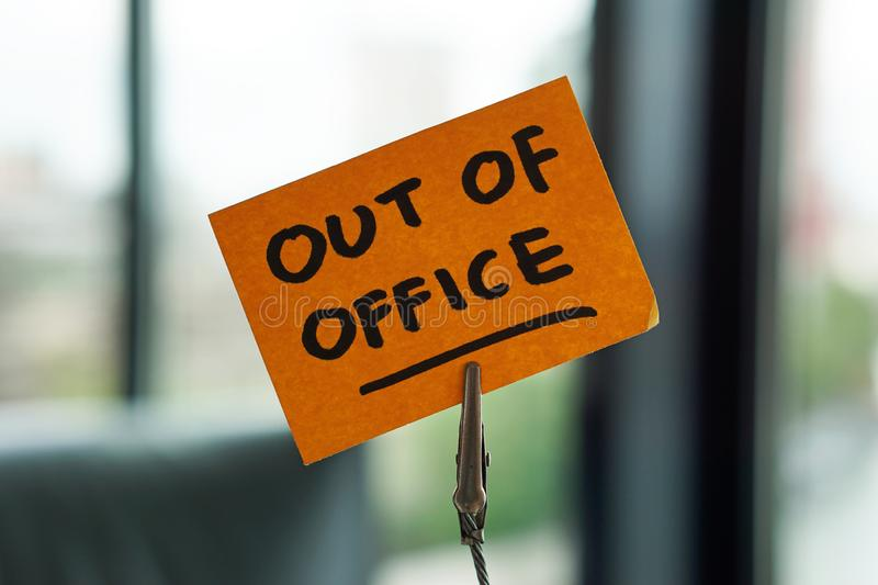 Ut of office written on a memo royalty free stock photos