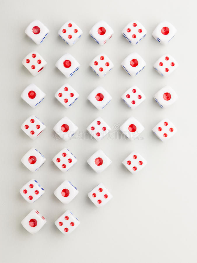 Out red cross pattern. Cross pattern of red side up dice with outer space cut on gray background royalty free stock photos